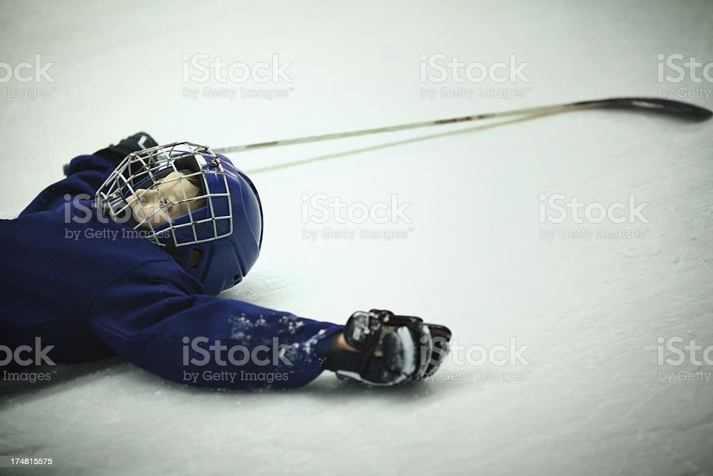 Junior ice hockey player,exhausted. royalty-free stock photo