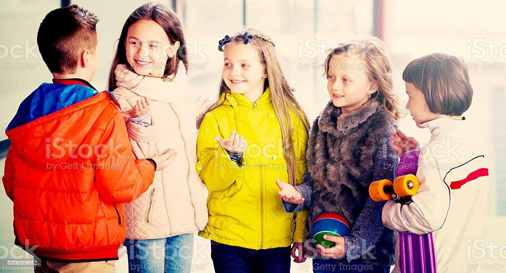 Junior kids chatting outdoor stock photo