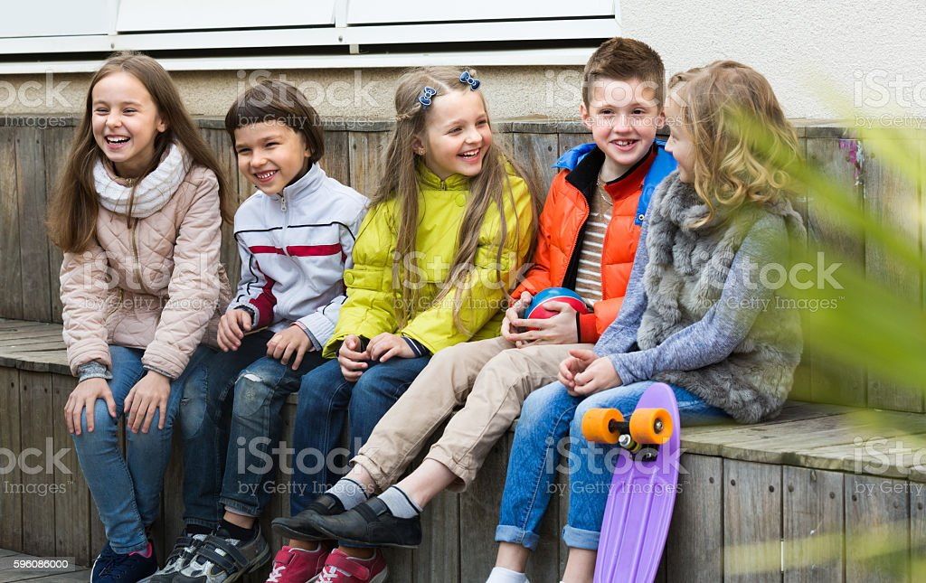Junior kids chatting outdoor stock photo