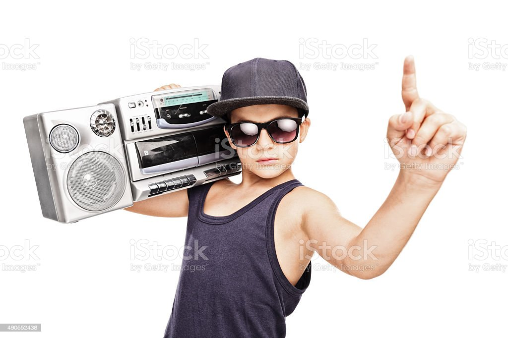 Junior rapper carrying a ghetto blaster and gesturing stock photo