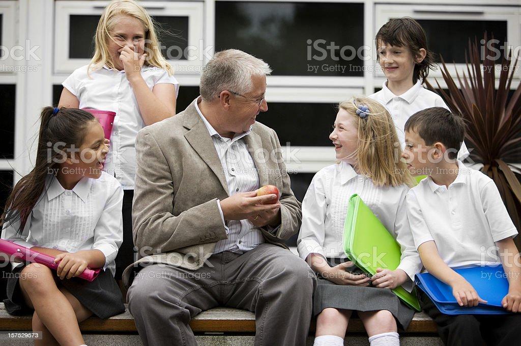 junior school: apple for teacher royalty-free stock photo