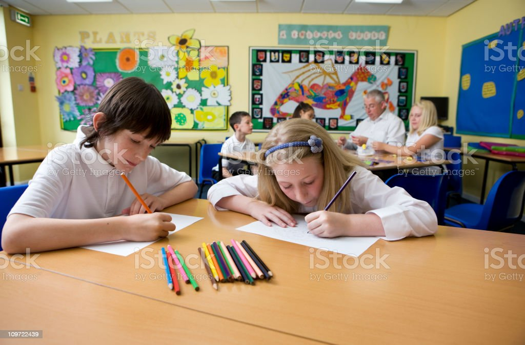 junior school: colouring in royalty-free stock photo