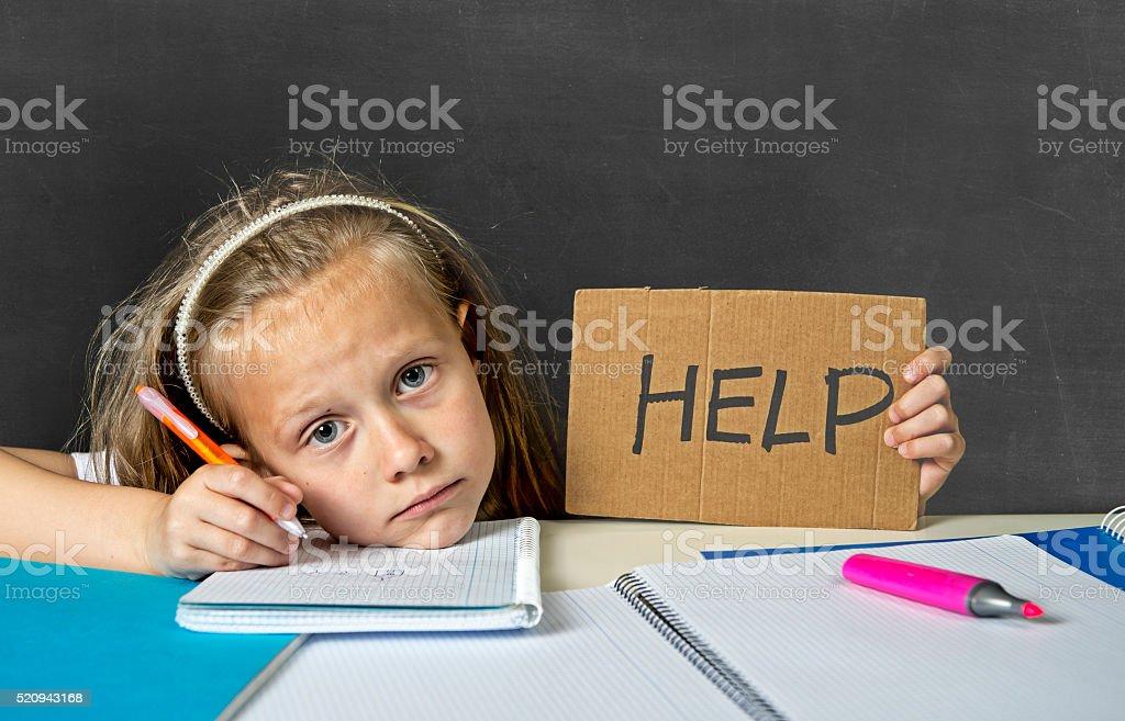 junior schoolgirl in stress working doing homework looking bored stock photo