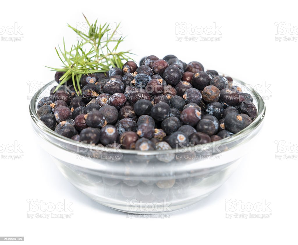 Juniper Berries in a bowl over white stock photo
