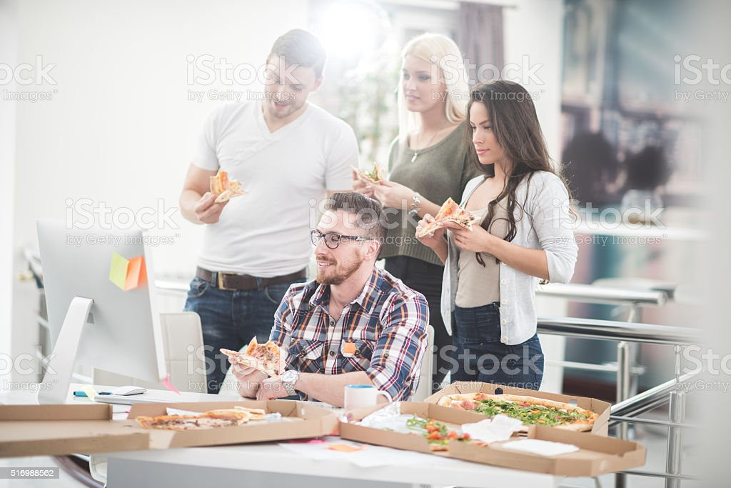 Junk food at work stock photo