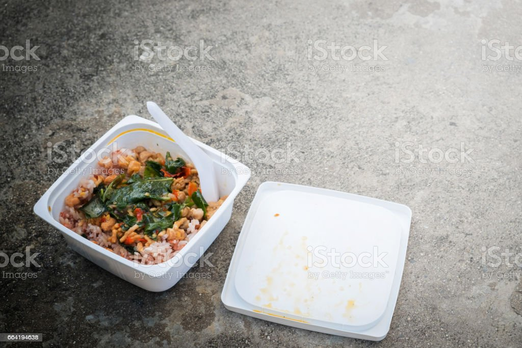Junk food, fried rice, fried Pork with Basil in plastic box. stock photo