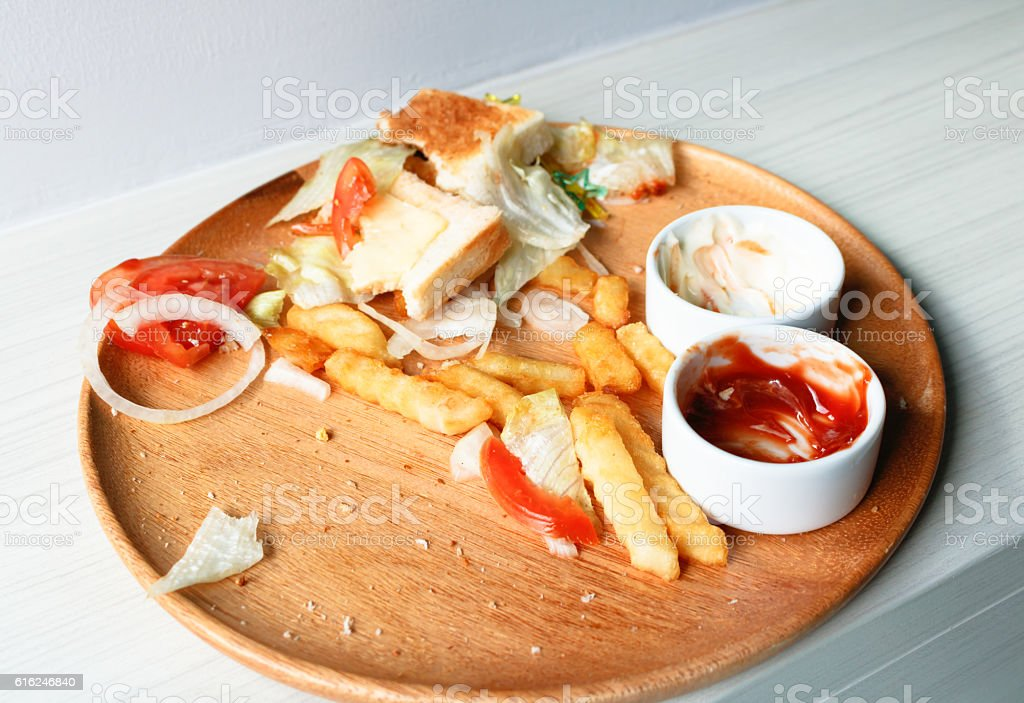 Junk food is wasted or spoiled food and other refuse stock photo