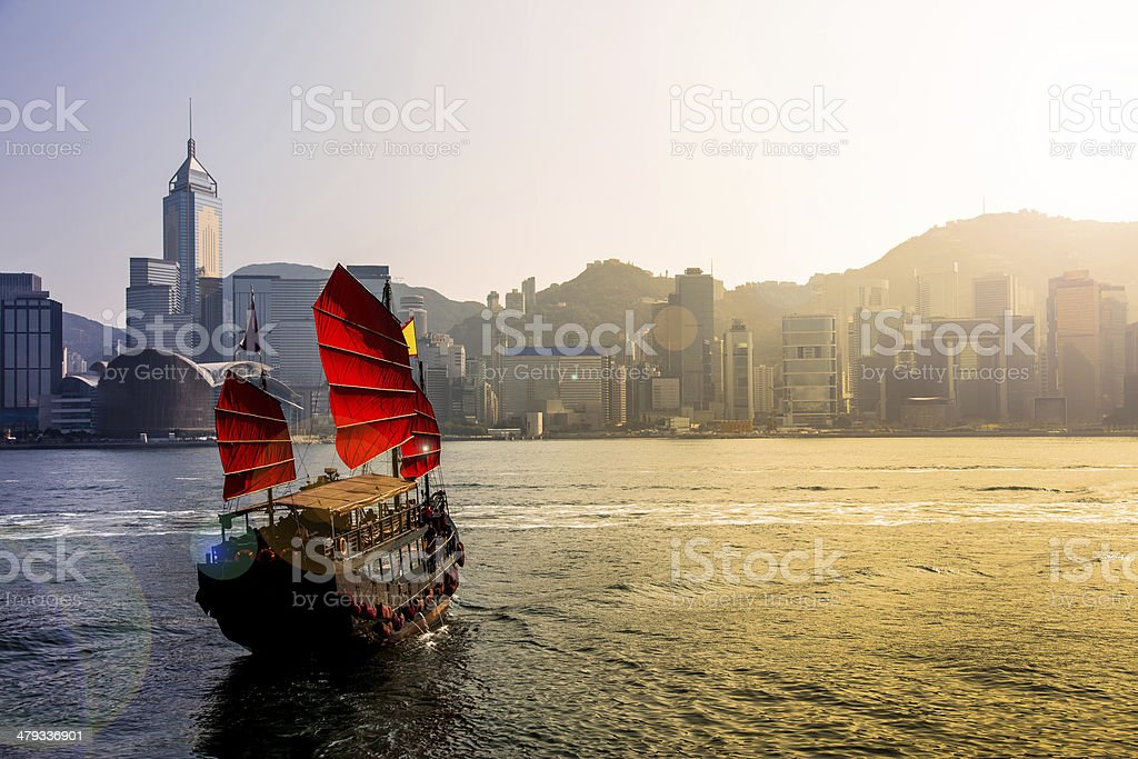 Junkboat in Hong Kong city stock photo