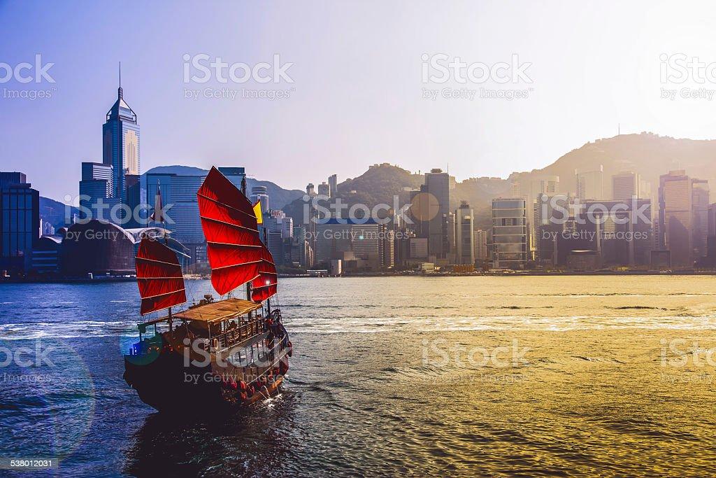 Junkboat in Hong Kong city stock photo