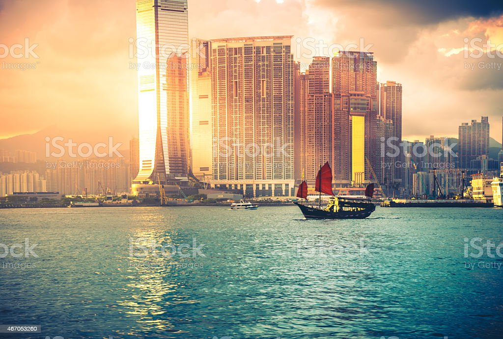 Junkboat in Hong Kong city / vintage color tone tuned stock photo