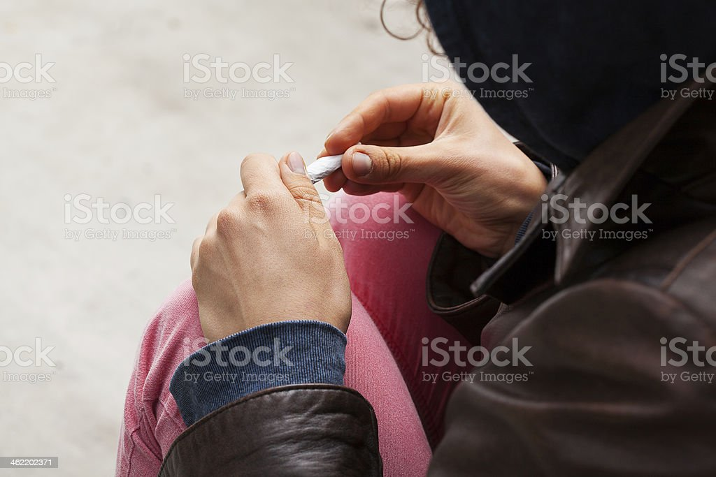 Junkie with joint stock photo