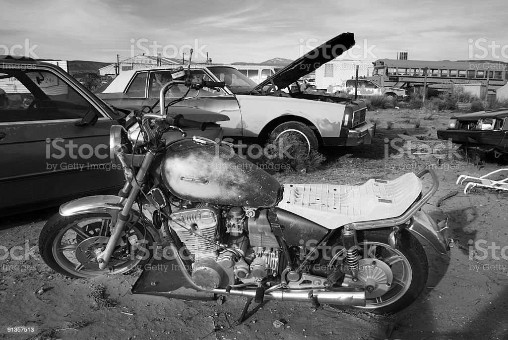 junkyard motorcycle in black and white royalty-free stock photo