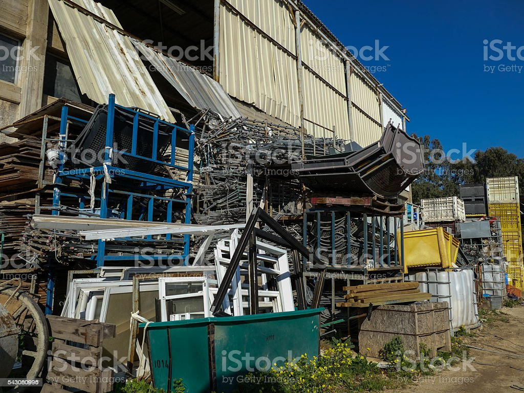 Junkyard with steel and plastic containers. stock photo