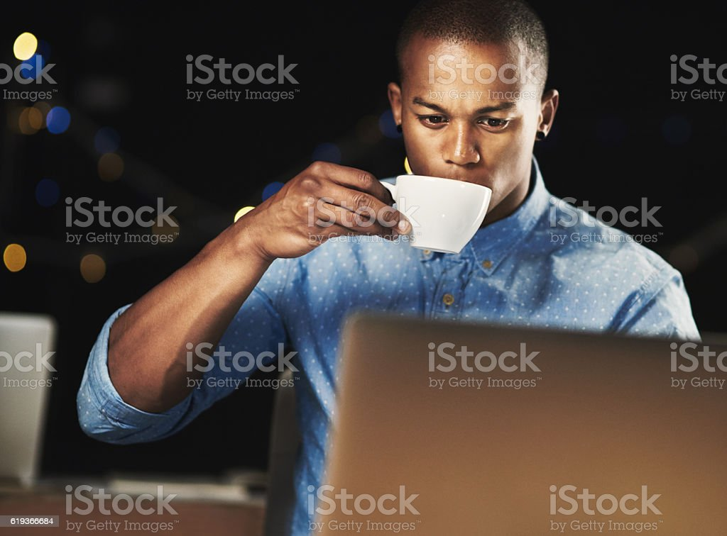 Just a little espresso to get him through the night stock photo