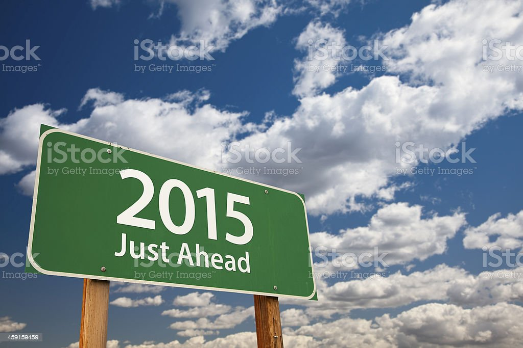 Just Ahead, 2015 Green Road Sign Over Clouds and Sky stock photo