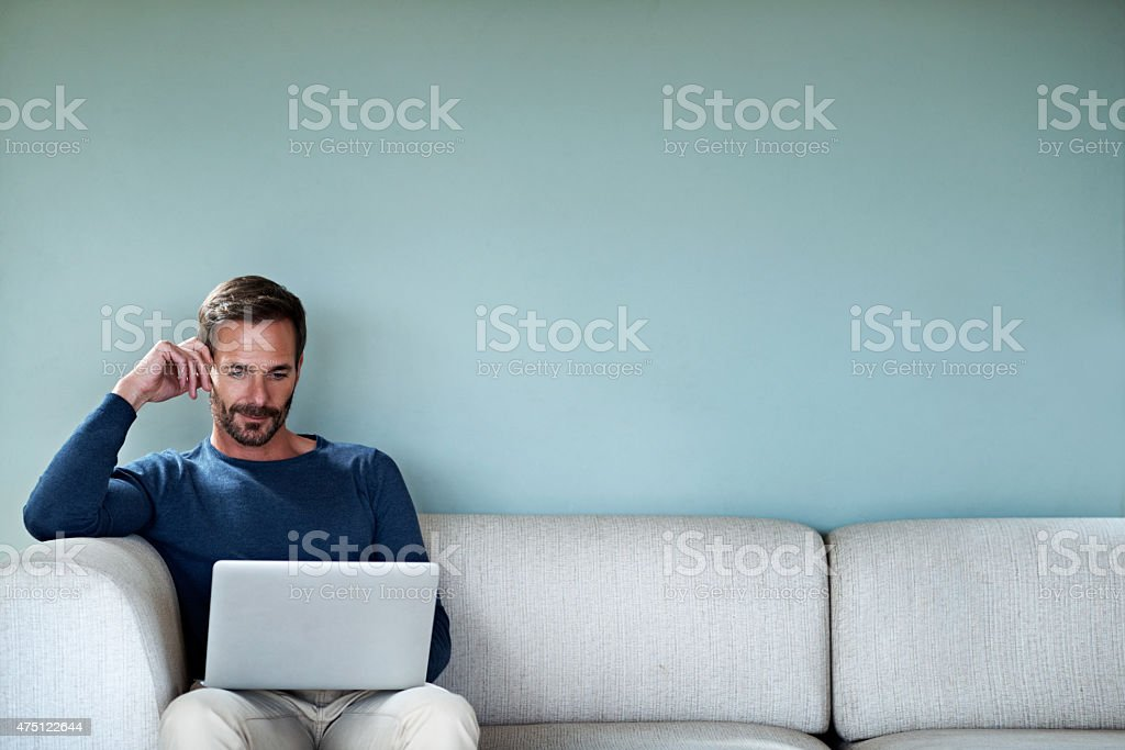 Just checking his emails stock photo
