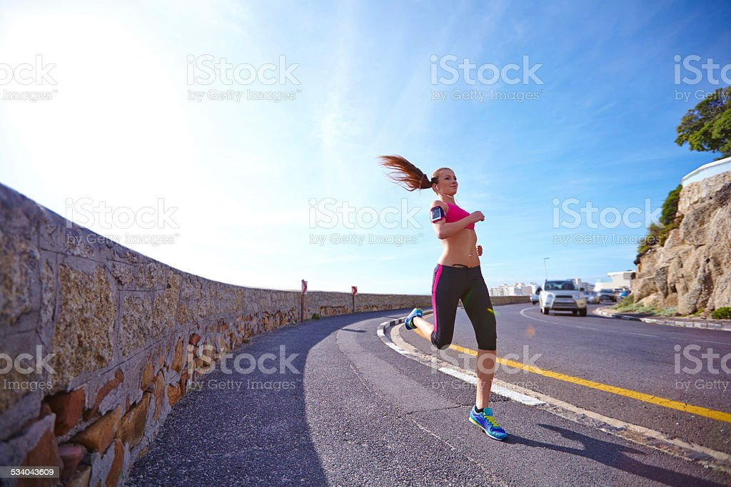 Just her and the road stock photo