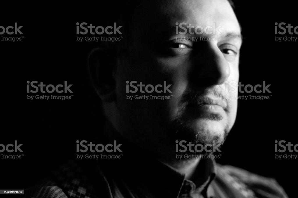Just like a mafia boss - chiaroscuro portrait with evil look stock photo