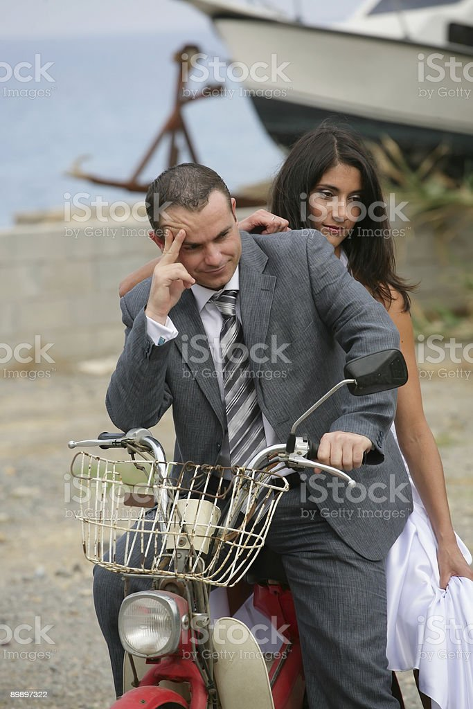 Just Married - bride and groom on aged motorcycle stock photo