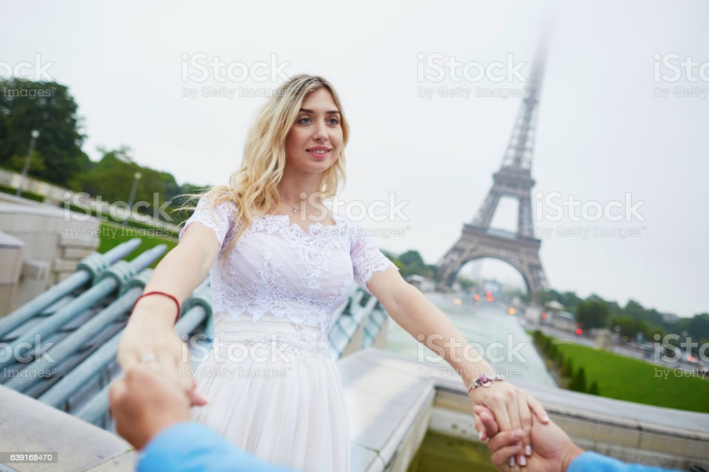 Just married couple near the Eiffel tower in Paris stock photo