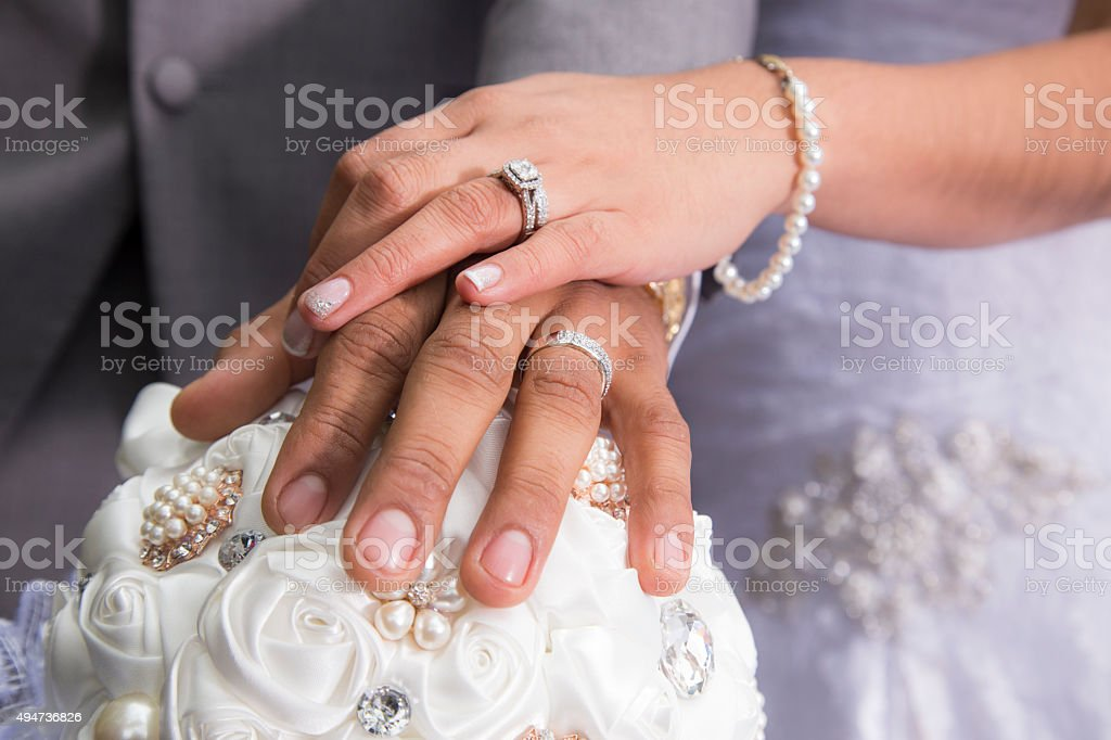Just married couple showing rings stock photo