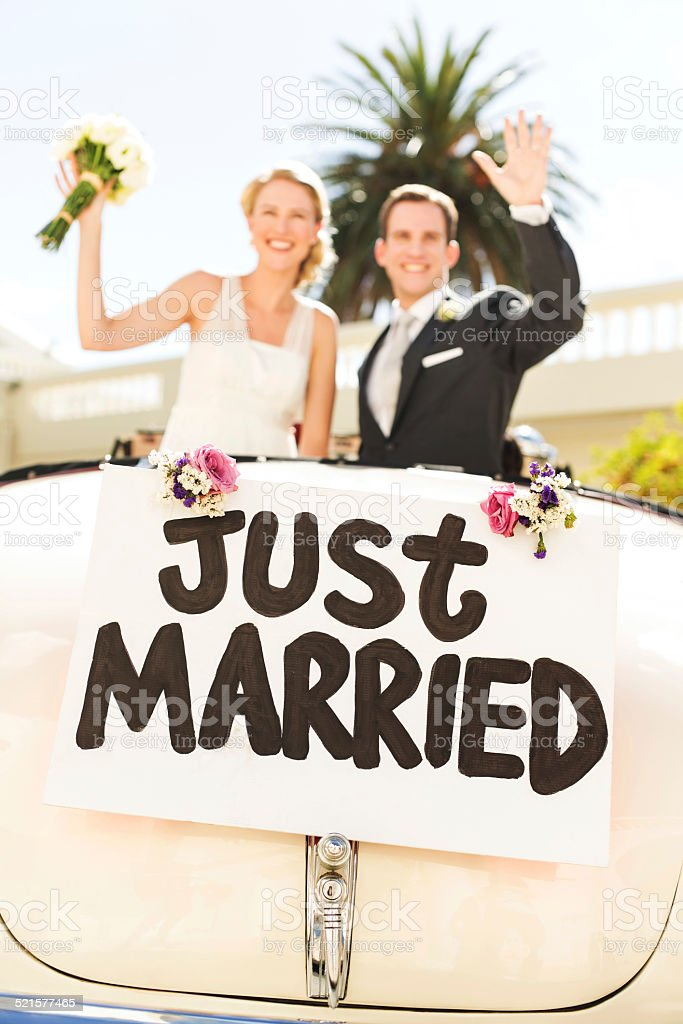 Just Married Couple Waving In Car stock photo