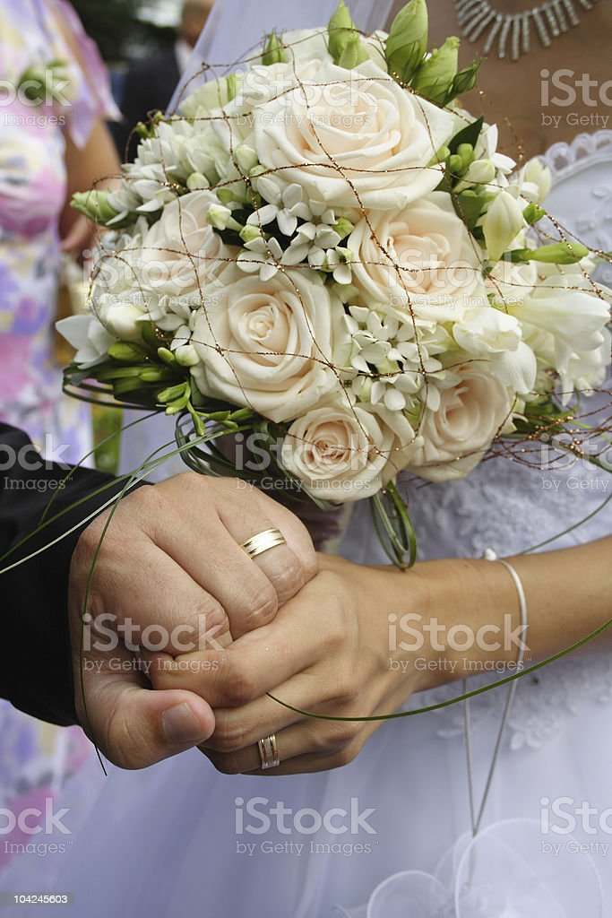 Just Married. Hands and bridal bouquet royalty-free stock photo