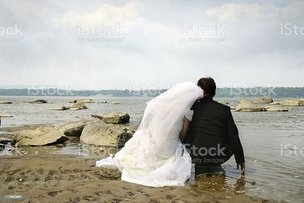 Just married relaxing, looking at the sea royalty-free stock photo