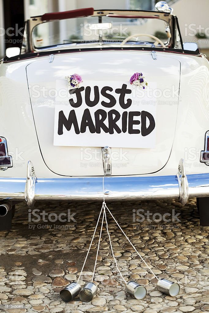 Just Married Sign And Cans Attached On Car's Trunk stock photo