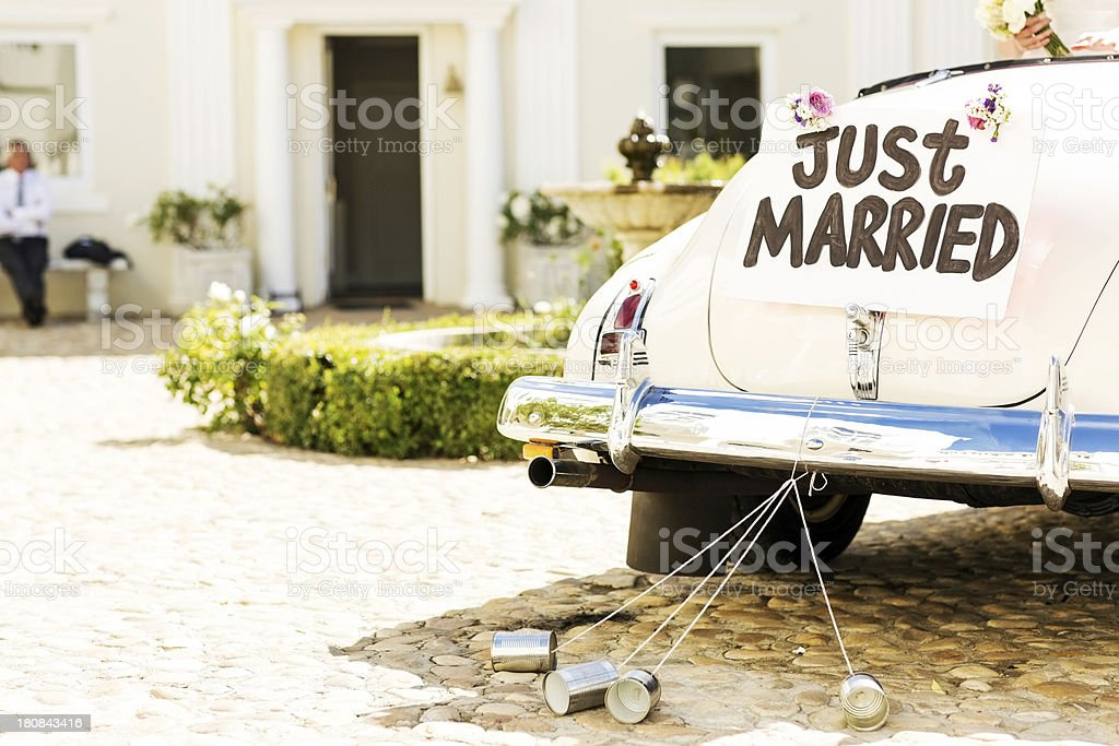 Just Married Sign And Cans Attached To Car stock photo