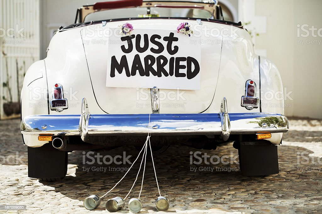 Just Married Sign And Cans Attached To Car's Trunk stock photo