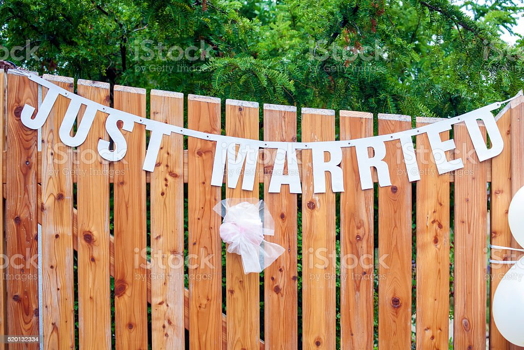 Just married text on the wall stock photo