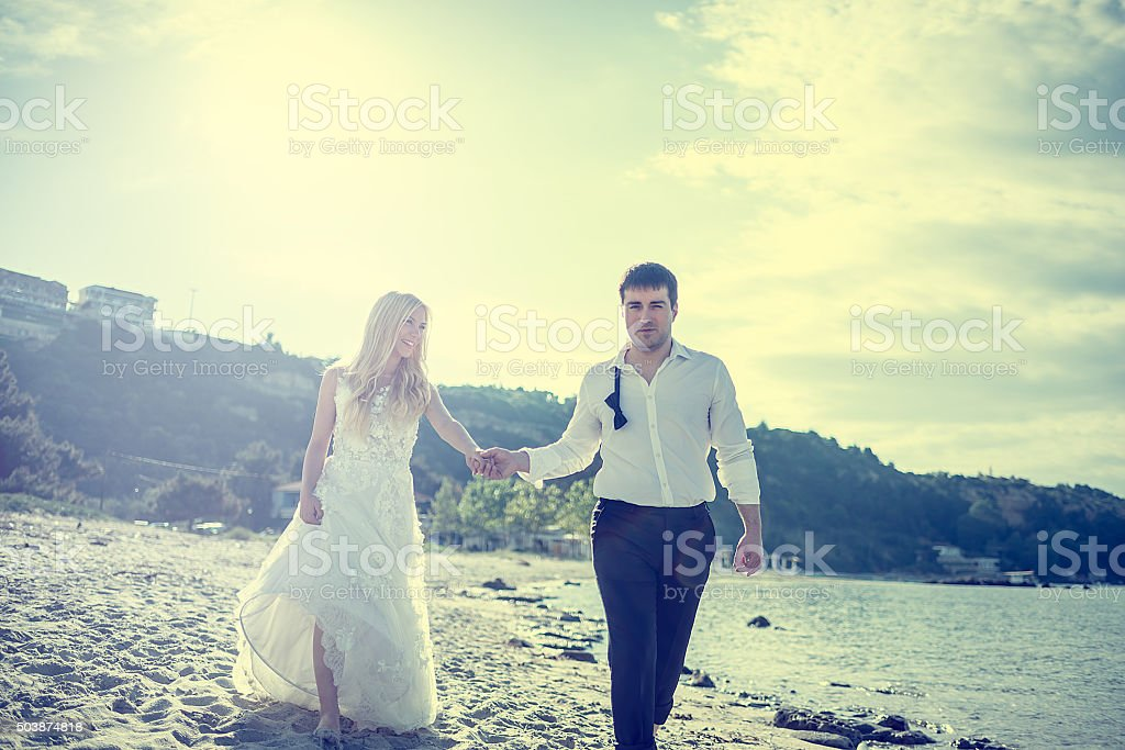 Just merried couple at the beach stock photo