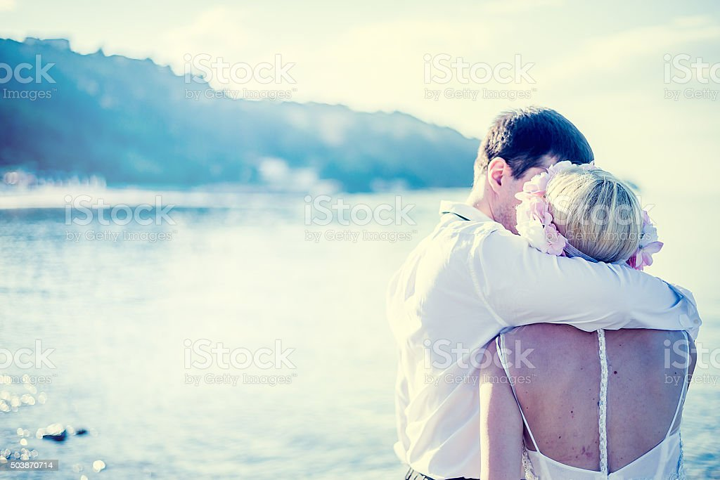 Just merried romance at the beach stock photo