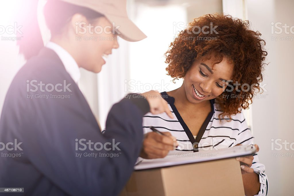 I just need you to sign over there stock photo