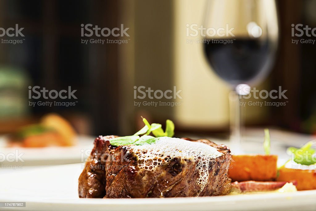 Just what a man enjoys: grilled steak and red wine stock photo