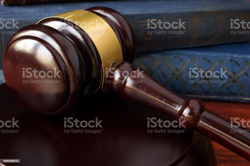 Justice concept. Gavel and book with law on a table. stock photo