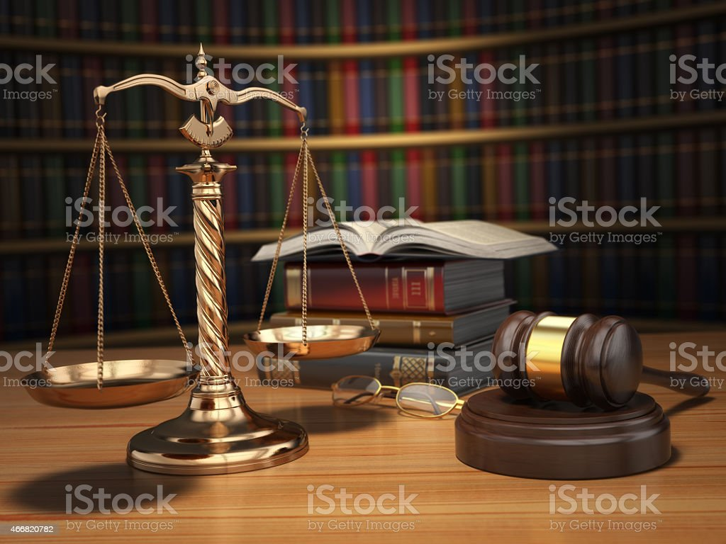 Justice concept. Gavel,  golden scales and books in the library stock photo