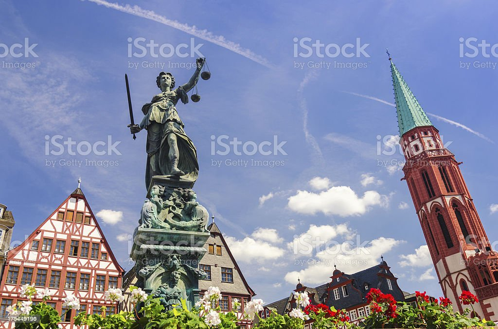 Justice (Justitia) fountain at Römer in Frankfurt stock photo