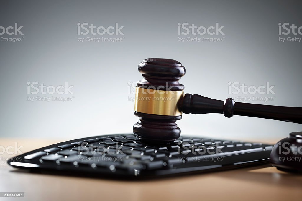 Justice gavel and computer keyboard stock photo