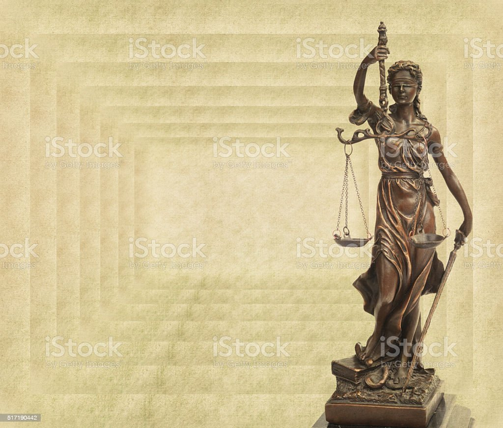 justice on old paper background stock photo