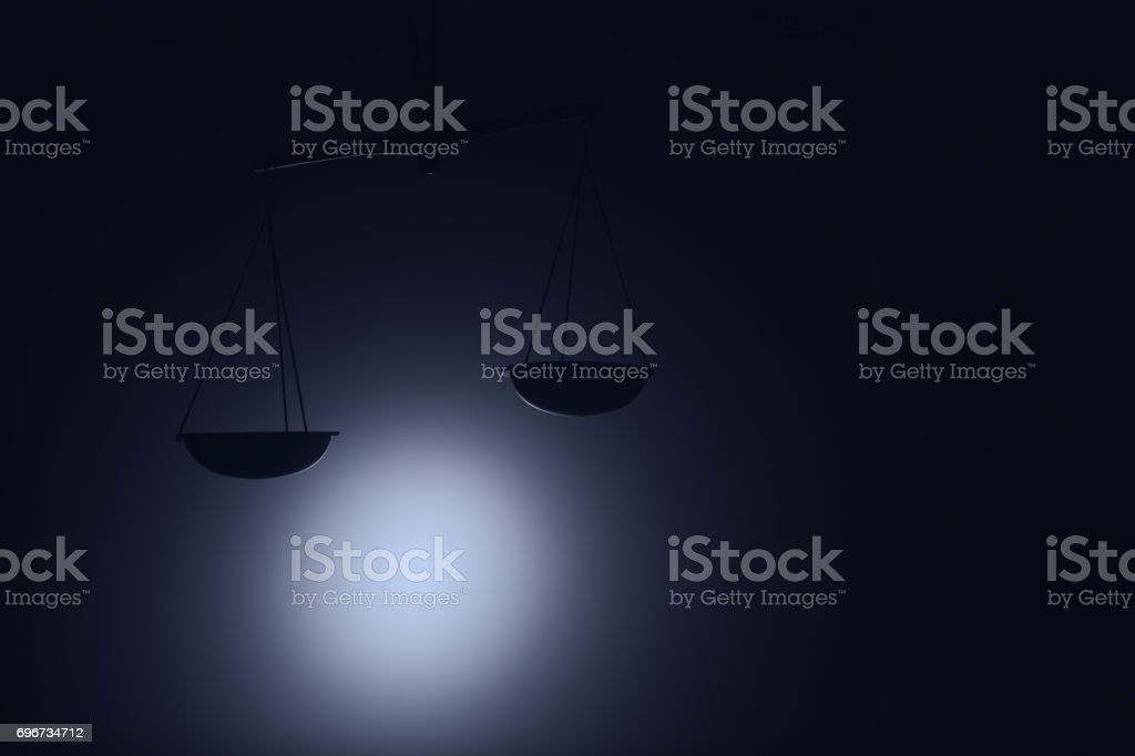 justice scale on dark background stock photo