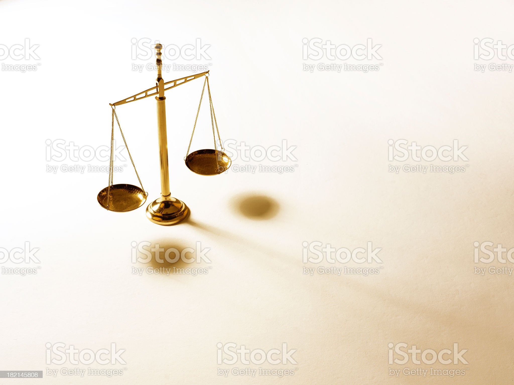 Justice scale on warm tone background royalty-free stock photo