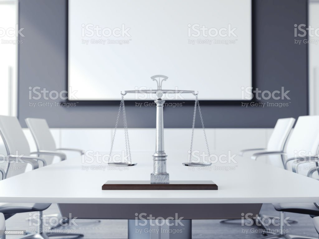 Justice scales on the white table. 3d rendering stock photo