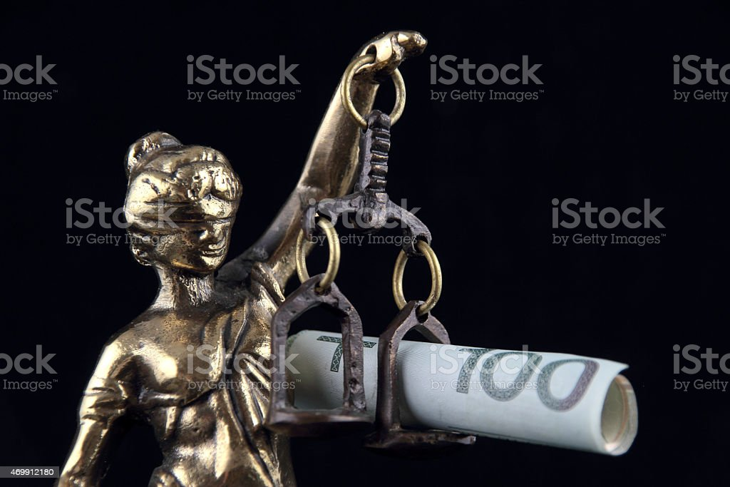 Justice Statue and polish banknote. stock photo