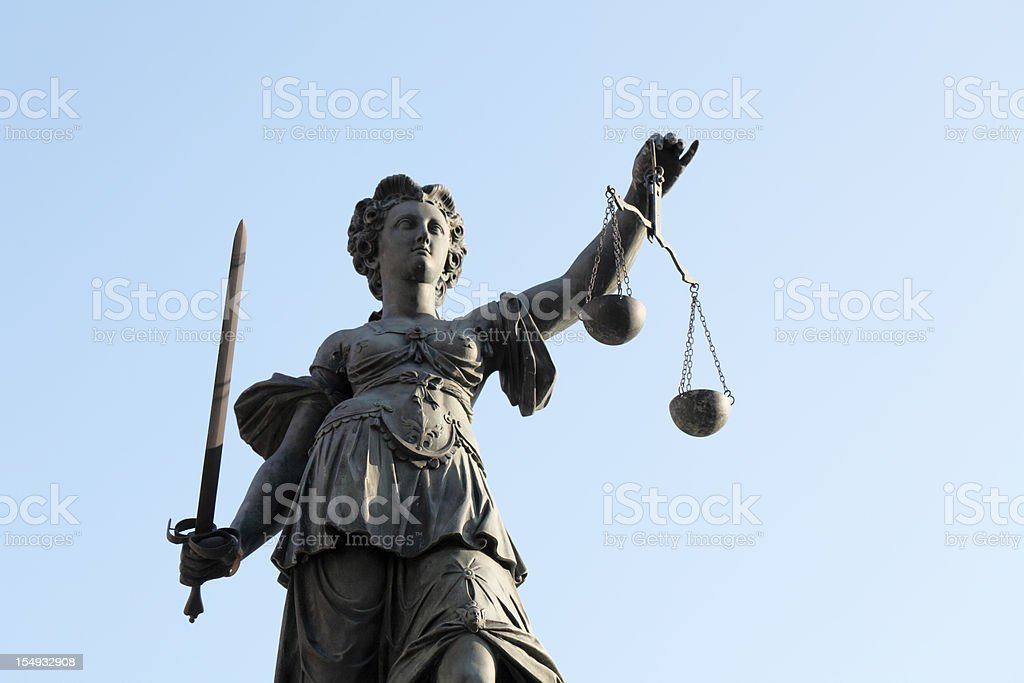 Justice statue with scale and sword royalty-free stock photo