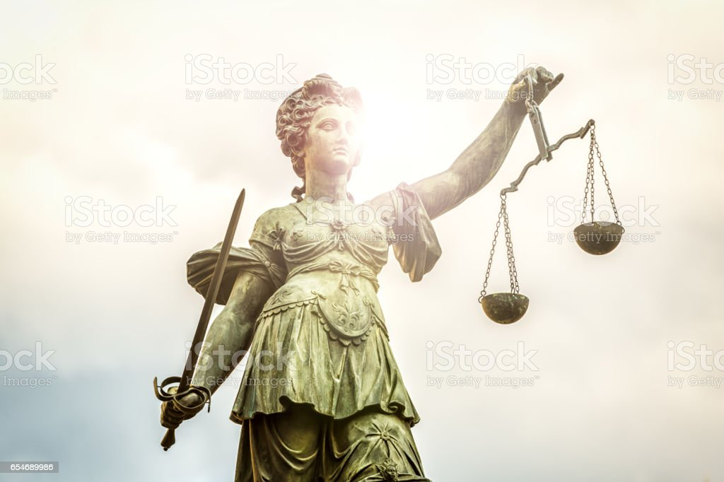 Justice statue with sunlight stock photo