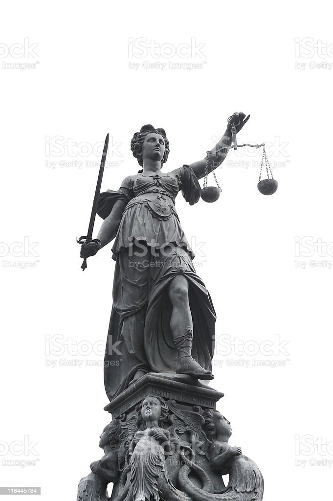 justice statue with sword and scale royalty-free stock photo