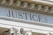 justice word engraved