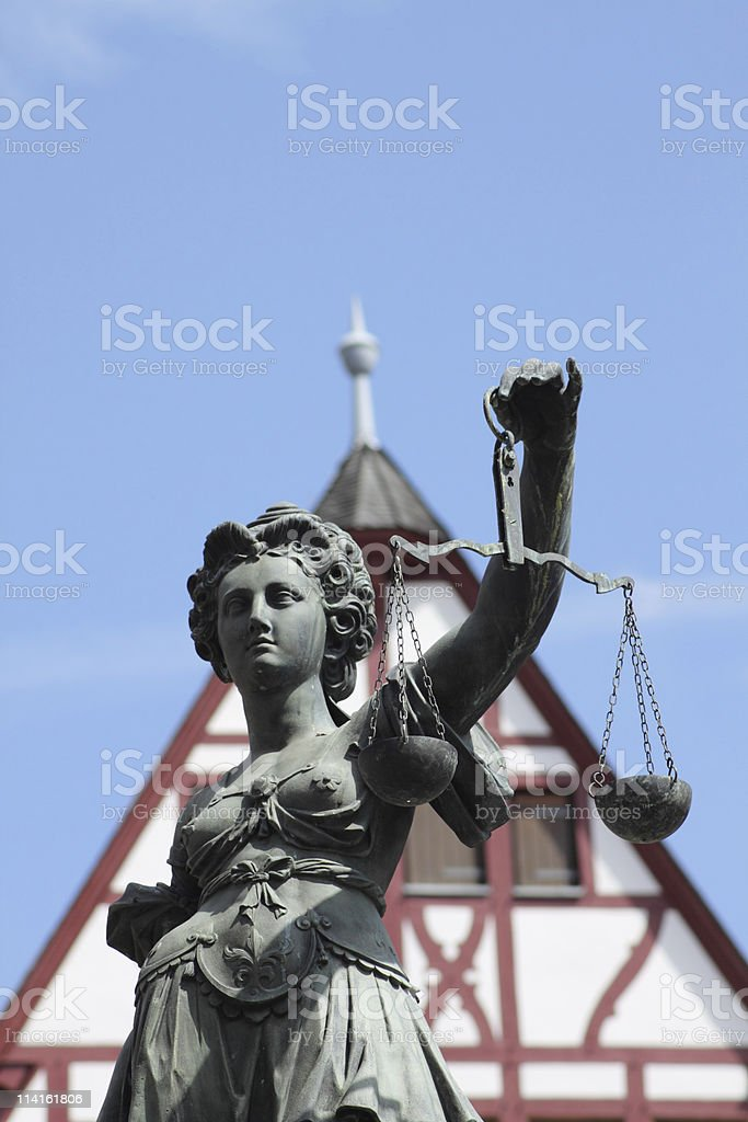 justitia in front of a house royalty-free stock photo